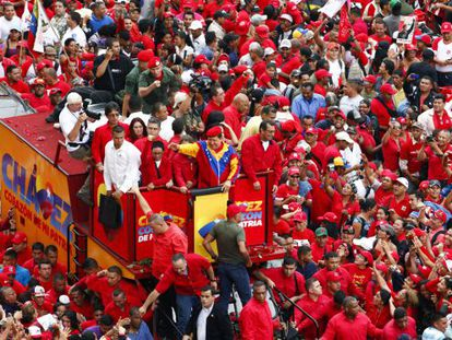 Supporters surround a truck carrying Venezuelan President Hugo Chávez as he makes his way to file his candidacy.