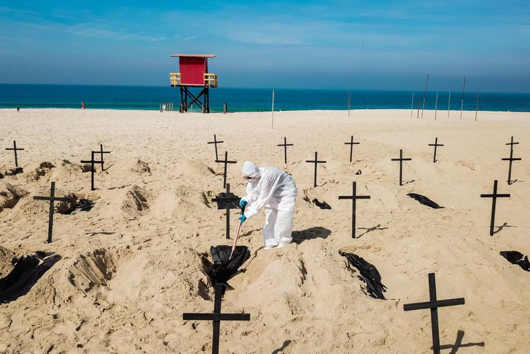 Protesters dig symbolic graves on Copacabana Beach in Rio de Janeiro to protest the government's handling of the coronavirus crisis.