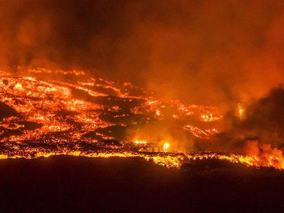 Lava destroys a home in the Canary Island of La Palma on Saturday.