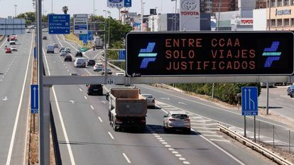 """Only justified travel allowed between regions,"" reads this sign on the S30 highway to Seville on Monday."