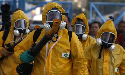 Rio health workers on Tuesday fumigate the Sambódromo, where Carnival celebrations will be held.