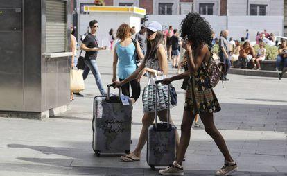 Tourists in Madrid's Puerta del Sol.
