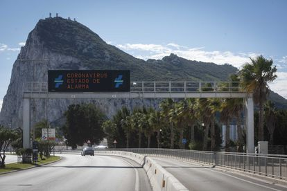 """Traffic sign reads """"Coronavirus state of alarm"""" on the border between Gibraltar and Spain."""
