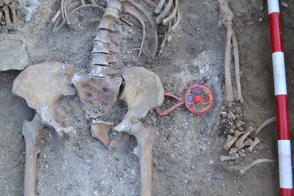 The remains of Catalina Muñoz Arranz next to the baby rattle, which were found in 2011.