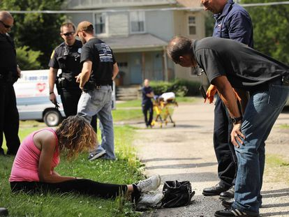 Police and paramedics attend a woman suffering from an overdose in Hamilton County.