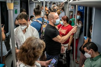 Dozens of passengers on Line 10 of the Madrid Metro system.