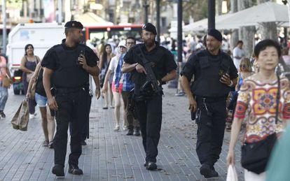 Mossos d'Esquadra Catalan regional police officers armed with anti-terrorist equipment on patrol in Barcelona.