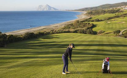 The Alcaidesa Links golf course in Cádiz with views of Alcaidesa beach and Gibraltar in the distance.