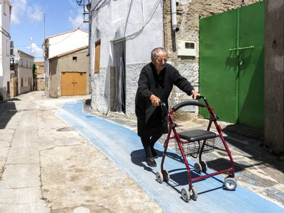 Rosa, 86, walks along a special anti-slip path in Pescueza.