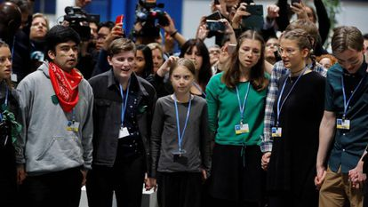Greta Thunberg and other youths at the Madrid climate change summit on Friday.
