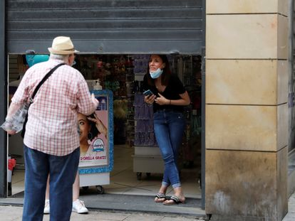 People talk on the street after a judge barred Catalan authorities from enforcing a stricter lockdown on the city of Lleida.