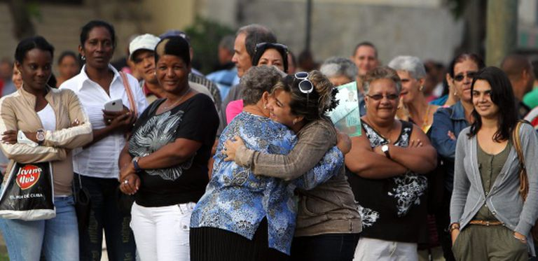 Two women in Havana celebrate obtaining a visa to travel to the US.