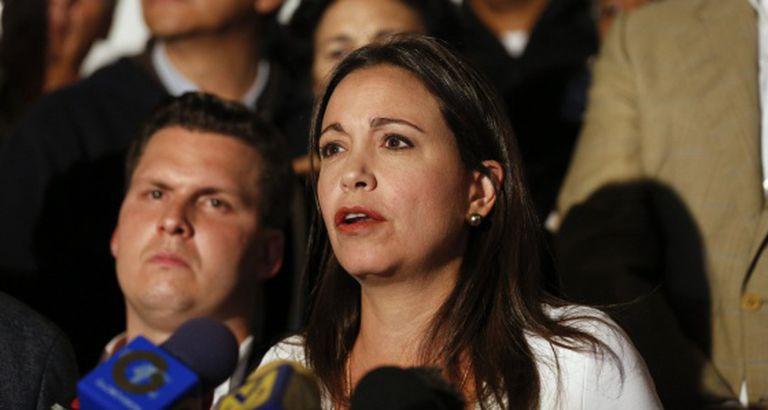 Opposition Deputy María Corina Machado speaks to reporters.