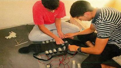 Youssef Aalla and Younes Abouyaaqoub fitting a vest with explosives.