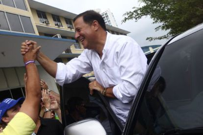 Juan Carlos Varela greets his supporters ahead of the Sunday vote.