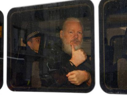 Assange in transfer after being detained in London.