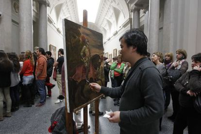 An artist creates a reproduction of one of the works in Madrid's Prado Museum.
