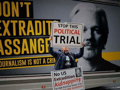 A pro-Assange demonstrator protests outside the Old Bailey court in central London on September 8.