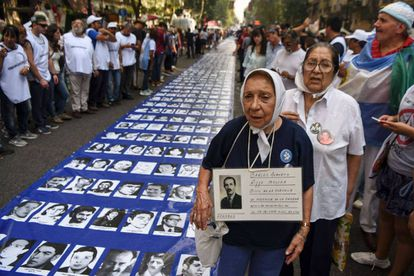 Marchers show photographs of the disappeared, whose numbers have been questioned by the Macri administration.