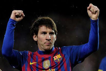 Lionel Messi celebrates one of his goals against Granada.