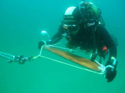 An archeologist conducting a study off Lago beach in Lugo, Galicia.