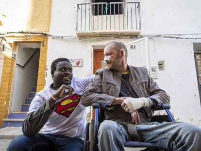 Gorgui Lamine and the man he saved, Alex Caudeli, in front of the latter's house.