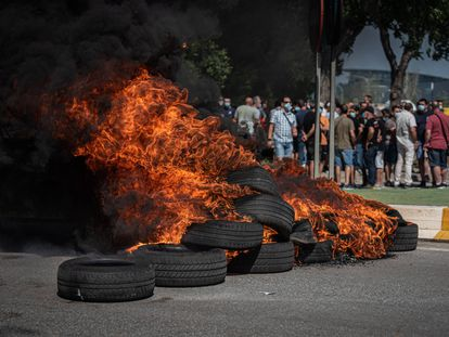 Nissan workers burn tires on Thursday to protest the announcement that the Barcelona plant will shut down in December.