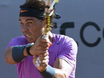 Rafael Nadal serves during his comeback match against Federico Delbonis Wednesday