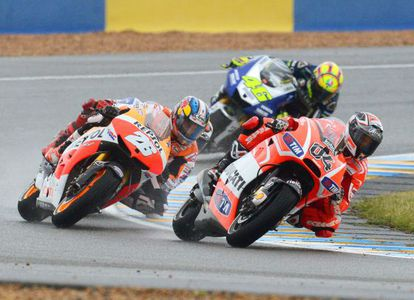 Dani Pedrosa of the Repsol Honda Team, Italian riders Valentino Rossi (back) of the Yamaha Factory Racing team and Andrea Dovizioso of the Ducati Team in action during the Motorcycling Grand Prix of France.