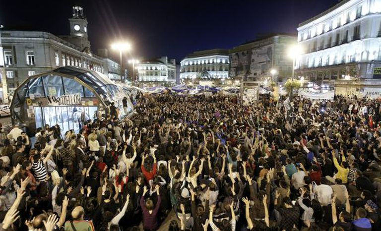 Protestors from the 15-M movement occupy Madrid's Puerta del Sol in 2011.