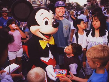 Mickey Mouse greets children at Disneyland Paris