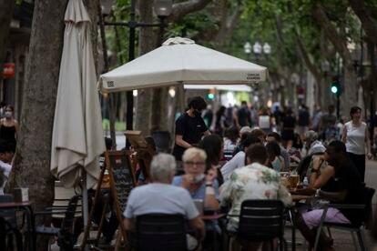 Sidewalk cafés in Rambla del Poblenou in Barcelona.