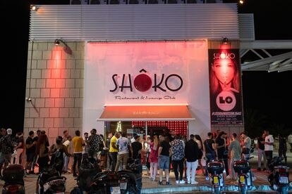 Young people wait in line to enter the nightclub Shoko in Barcelona.