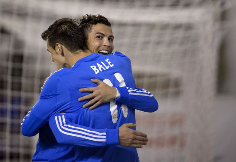 Real Madrid's Portuguese forward Cristiano Ronaldo (R) celebrates with  Welsh striker Gareth Bale.