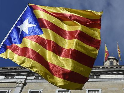 A Catalan pro-independence flag in front of the Catalan government headquarters.