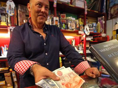 Fernando Losada still accepts pesetas at his Madrid stationery store.