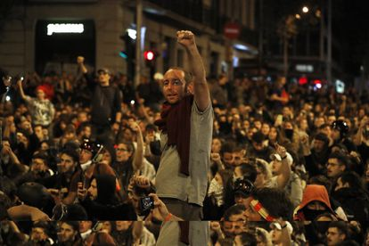 A group of protesters take part in a sit-in in Urquinaona square in Barcelona on Saturday.