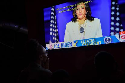 People watch Kamala Harris deliver a speech after being elected vice president of the United States.
