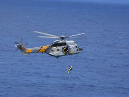 An archive image of a Spanish Maritime Search and Rescue helicopter.