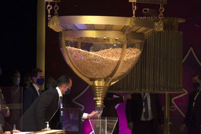 Personnel checking one of the drums containing the balls with the lottery numbers ahead of the draw on Tuesday.