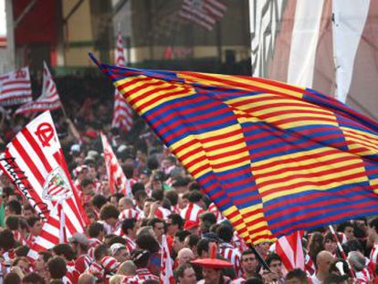 Athletic and Barcelona fans gather outside Valencia's Mestalla stadium ahead of the 2009 final.