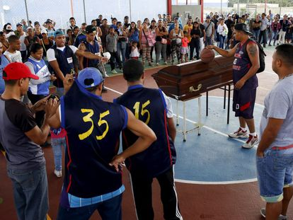Mourners attend the funeral of a murder victim in Caracas.
