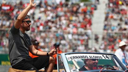 Fernando Alonso greets fans at the Canadian Grand Prix.