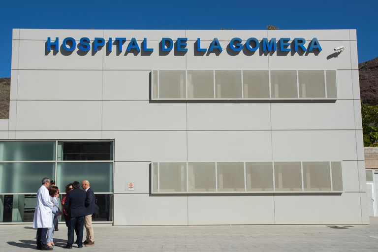 Doctors and members of the regional government outside the hospital in San Sebastián de La Gomera.
