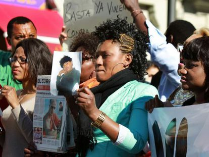 Friends of a Nigerian woman who has died after allegedly being beaten by a kung fu instructor hold a demonstration against gender violence in Bilbao on Tuesday.