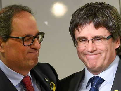Quim Torra and Carles Puigdemont during a press conference in Berlin.