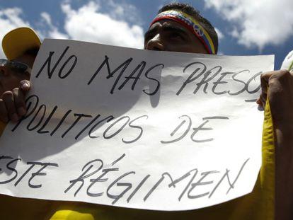 A demonstrator attends a protest in Caracas following the arrest of Caracas Mayor Antonio Ledezma.