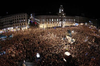 """15-M protestors held a """"silent scream"""" for a minute at midnight in Madrid's Puerta del Sol square."""