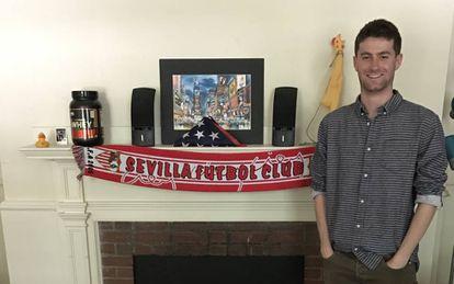 Harvard student Chris Ulian at his digs, with Sevilla FC scarf.