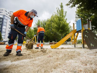 City workers cleaning up a playground in Santiago de Compostela.